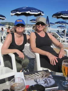 A stray photo of our landlady Toni and me having a drink on the beach after having spent the afternoon cycling.